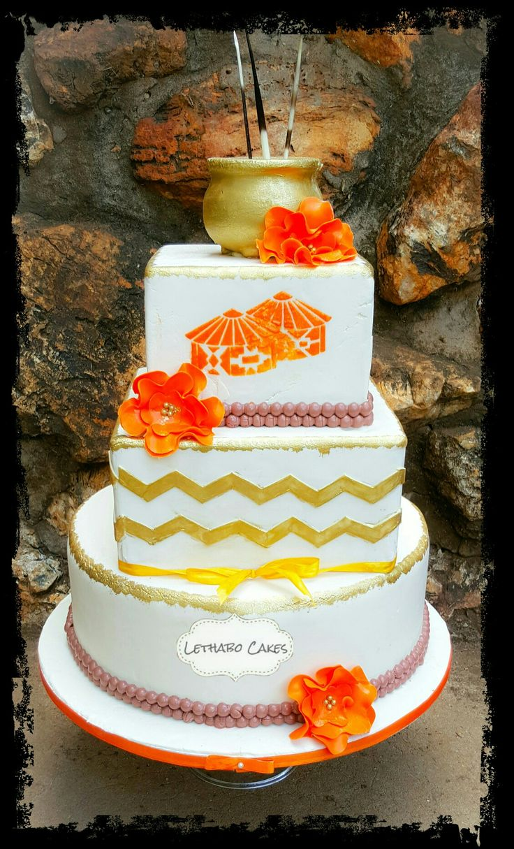Modern african traditional wedding cake with chevron and gold painted details.