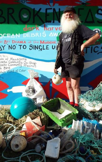 CAMPAIGN: Mallacoota arts leader Don Ashby stands among marine debris during the Easter weekend ocean awareness campaign which included the unveiling of murals and screening of a film. Pictures: Courtesy Julie Parker.