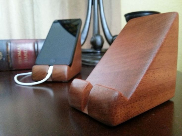 Beautifully simple, this wedge of mahogany wood will keep your iPhone at hand without any fuss.  Price: $29.95