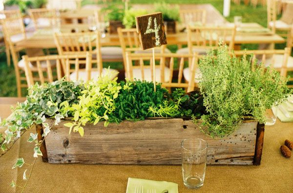 Wooden planter boxes made from reclaimed wood for wedding centerpiece on larger tables | I wouldn't want the table number sticking out of it, though | garden wedding