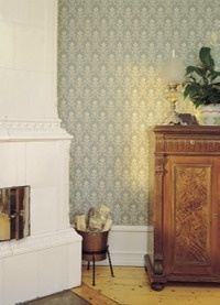 Swedish tiled wood stove and gorgeous wallpaper.