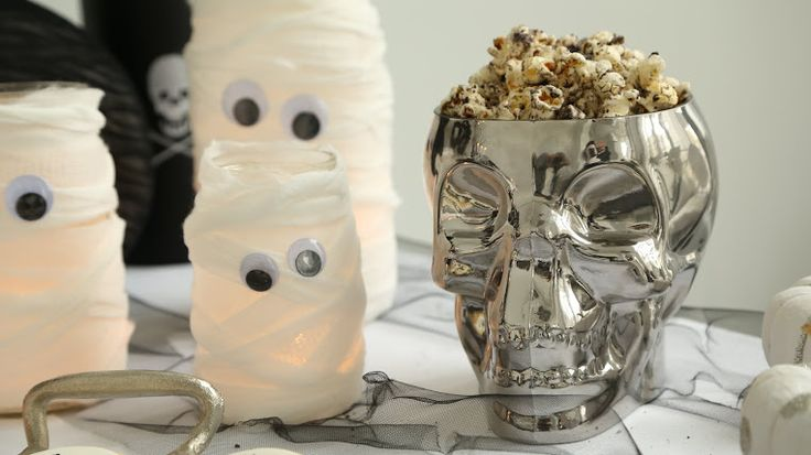 Adorable mummified candles for Halloween!  Learn how to make this DIY project here.