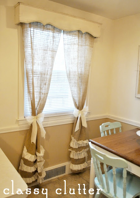 burlap curtains, bow tie backs, wood valance.  I especially love the wood valance!  Super cute!
