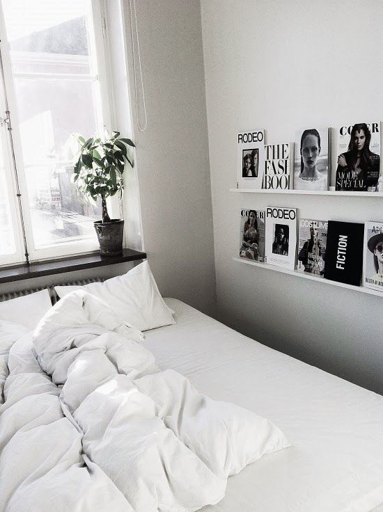 great idea for guest bedroom so friends always have something interesting to read and doubles as wall candy.