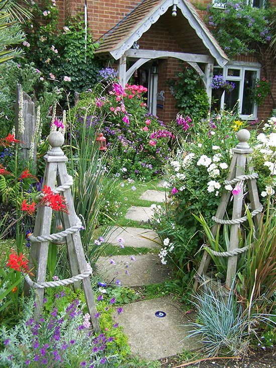 Found objects turned focal-point sculpture, edging made from repurposed objects, and plants traded over the fence should always find an easy home in a cottage garden.
