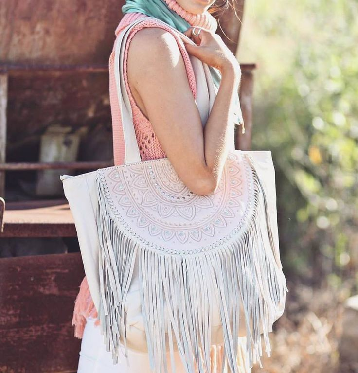 One of our favourites - the Ophelia Leather Boho Bag in cream & blush with our Riviara Knit in coral.  #leatherbag #travelbag #travelstyle #bohemian #bohoaccessories #bohostyle #bohofashion #handmadeleather