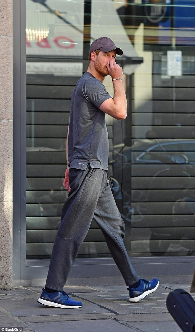 Prince Harry was spotted leaving a posh private members' gym today in a trendy part on London sporting a pair of trainers and a baseball cap