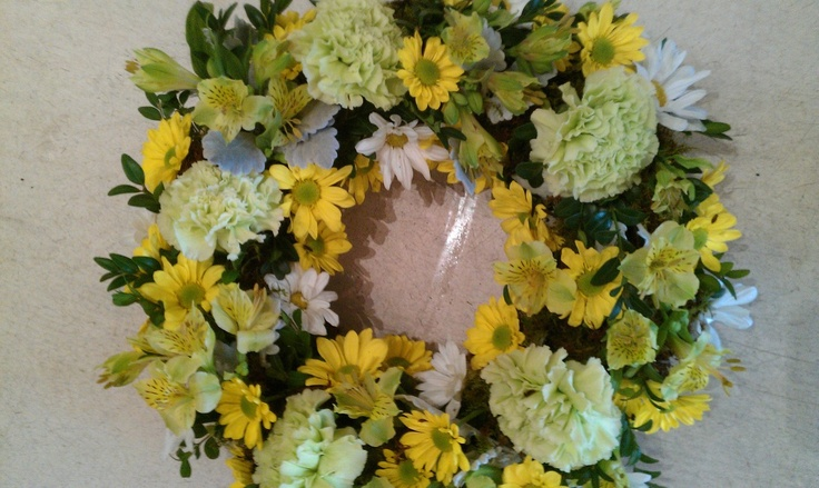 A Sympathy wreath of sims carnations, chryssies and alstro