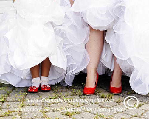Bride and flowergirl's red wedding shoes at their July wedding