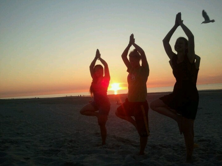 Yoga Class With Friends On The Beach Tree Pose
