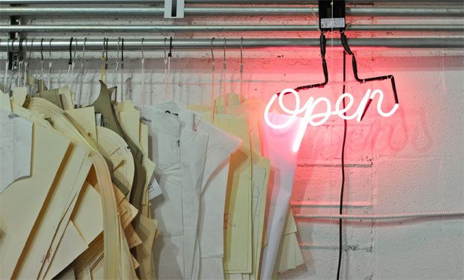 Updating the open sign with pink neon (via portland garment factory)