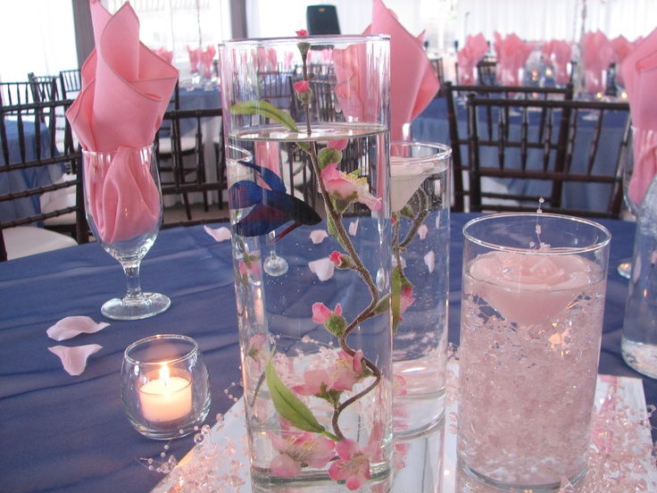 Beta fish in cylinder/ pink and navy wedding... seen just sais hewanted a fish on the table lol