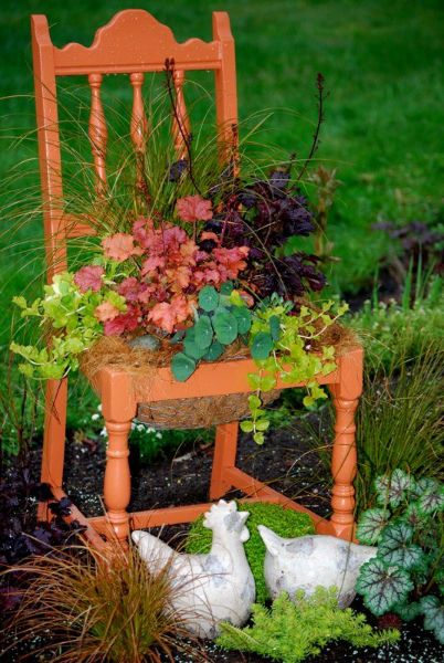 'Fall' into Flea Market Gardening Contest Winner!  First Place – Carolyn Hart Gutierrez who photographed her garden chair is a luscious melon color, with an arrangement of fall plants and flowers in the seat.