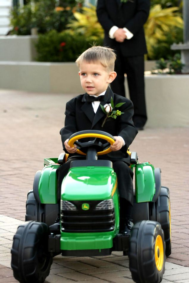Ring bearer comes down the aisle on a mini tracker. hahahaha. i can see this happening at some of my friend's weddings