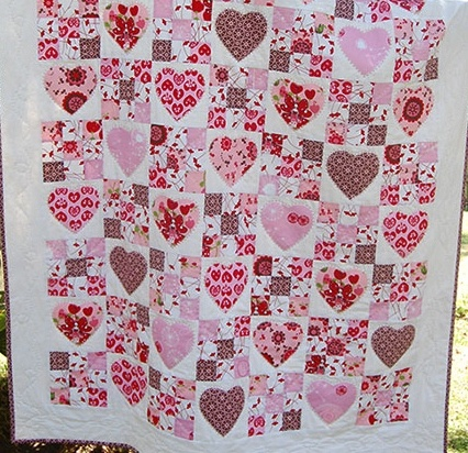 My all time favorite quilt...I snuggle under it nightly :0) It was a kit i got from Saffron Craig...I just love her fabrics she would have to be one of my all time designers :0)