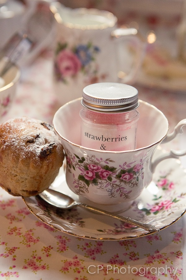 Hire original vintage tea cups and saucers from Fuschia.  Our cute strawberry and cream candy jars look great in these to give to guests as table favours.  From www.fuschiadesigns.co.uk.