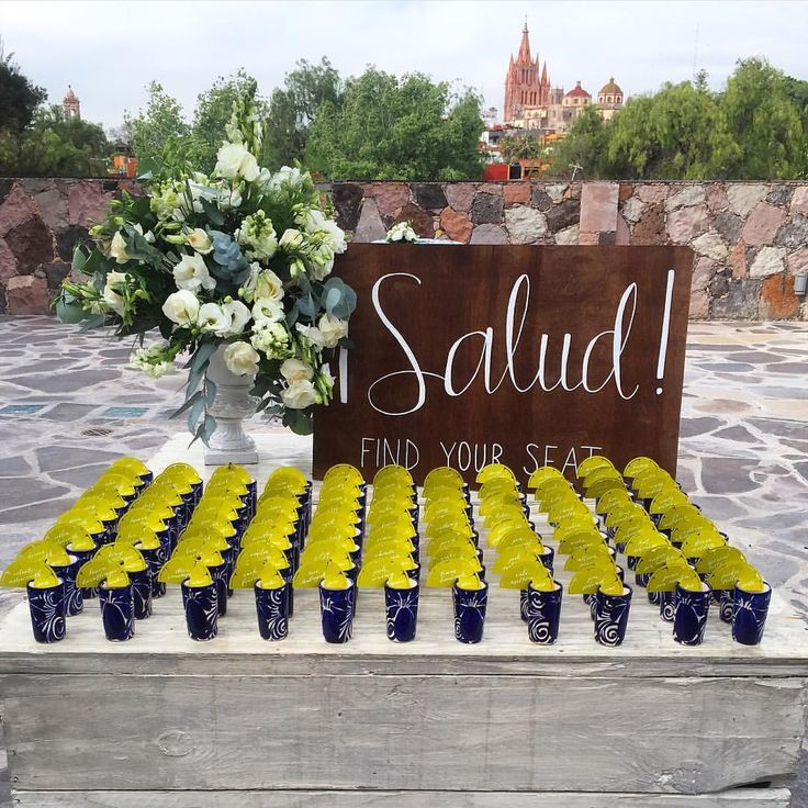 We created these ADORABLE lasercut LIME escort cards that fit on the edge of classic blue & white shot glasses! The guests were able to take a shot of tequila as they found their table assignment! Creating unique and interactive details always makes the wedding more memorable and fun!  #turndownforhut #thatcathedralthough