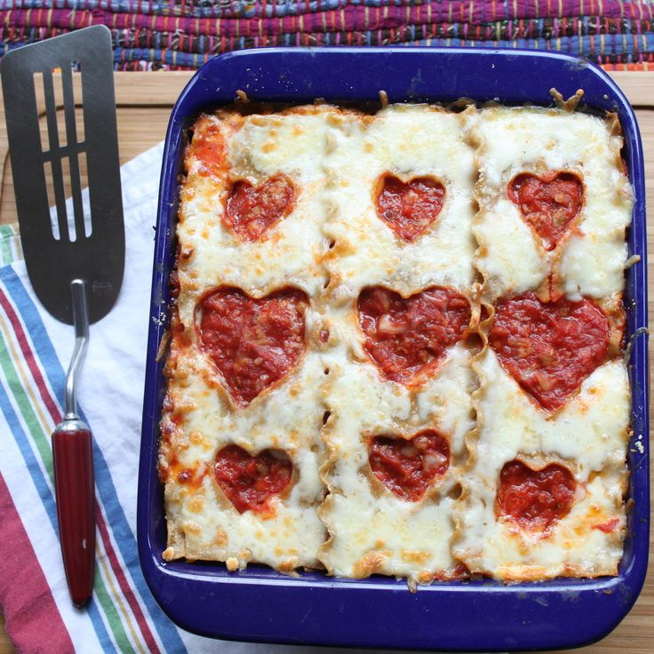 Heart Lasagna Recipe ~ Turn your lasagna into a special Valentine's dinner by cutting heart shapes out of the cooked lasagna noodles
