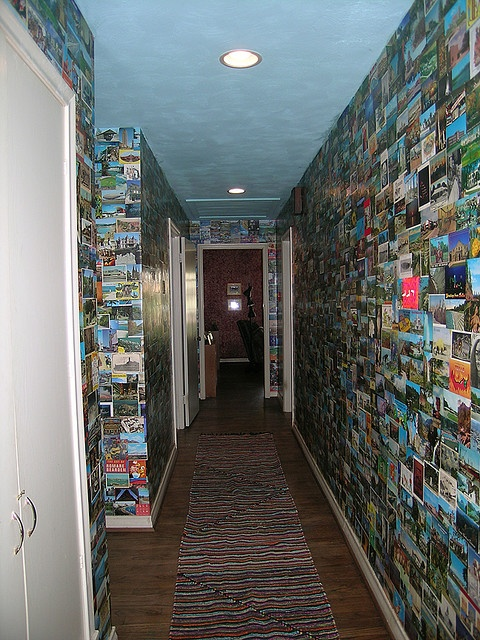 A hallway collection of post cards - pasted to the walls with Elmer's glue.  (Obviously not for renters!)
