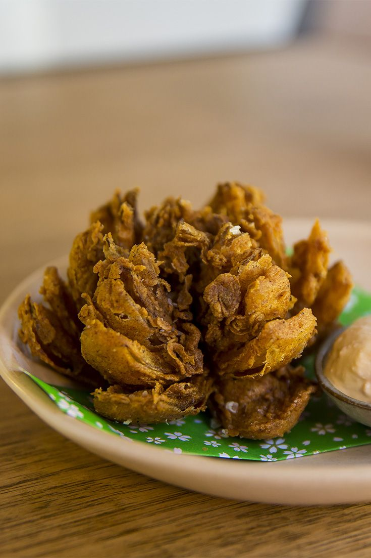 Tear off crisp-edged, creamy centred 'leaves' from the 'Blooming Onion' and dip them in creamy, fermented habanero-spiked soy and tofu emulsion.
