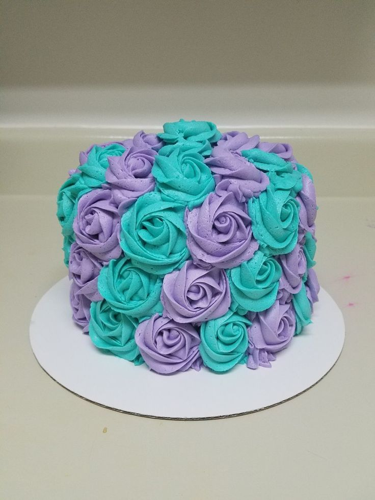 Teal and purple buttercream rosette cake. Contact Heather @804-283-4641