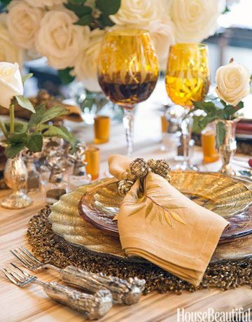 """""""The best tables are all about the accessories,"""" says designer Amen Wardy.  Try adding special objects to each place setting such as the tiny silver vases, silver napkin rings, and individual salt and pepper shakers."""