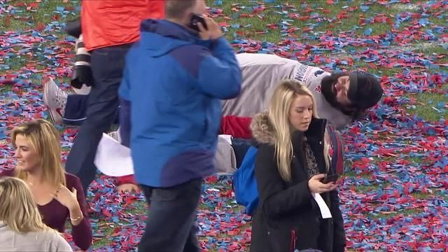 New England Patriots defensive coordinator Matt Patricia makes confetti angels after the game