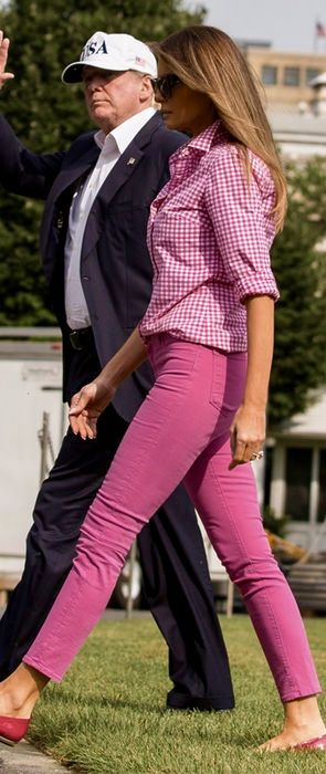 August 27, 2017 First Lady Melania Trump in J. Crew shirt and J. Brand skinny jeans returning to DC after Camp David weekend.