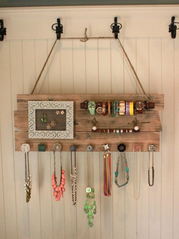 so awesome, i could sooo make this.... only, id make that picture frame on hinges so I can open it up to put studs on it as well as the hanging earrings... :)