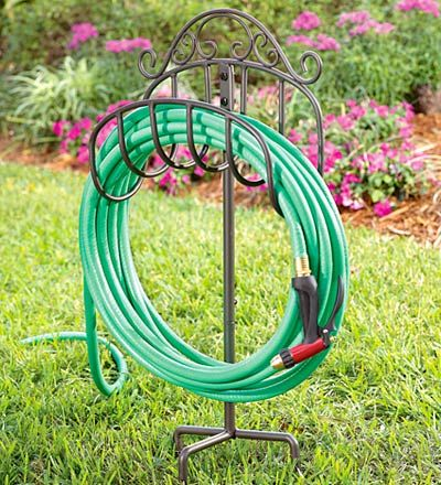 Graceful scrolls of wrought iron give this lightweight, portable Hose Holder an elegant appearance that looks great anywhere in your yard.