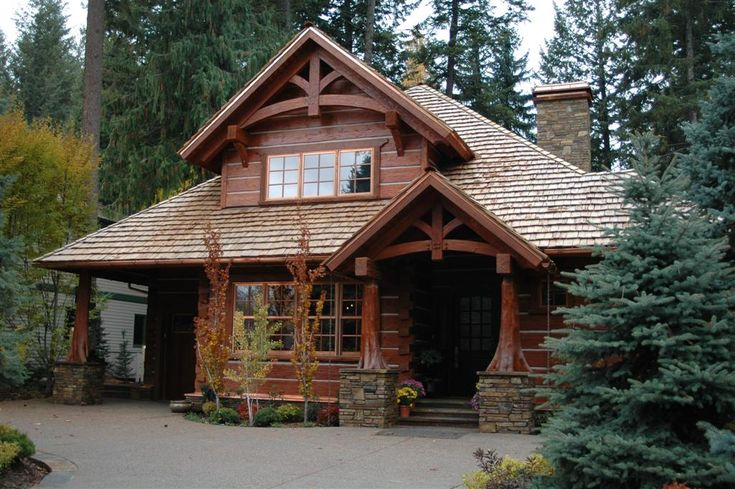 The owner of this home carefully positioned their home to keep surrounding trees, creating a private oasis on a relatively small lot | Handcrafted Dovetail Log Home | Caribou Creek Log Homes