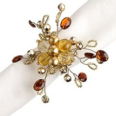 """Beaded Gold & Amber Flower Napkin Ring.  Pier one.  Beautiful!  They are officially on my """"must have"""" list.  Affordable, too!"""