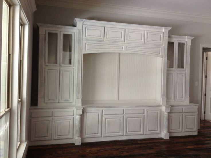 shabby chic white wooden entertainment center as display. Black Bedroom Furniture Sets. Home Design Ideas