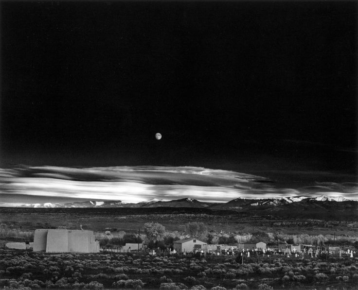 """For many, Moonrise, Hernandez, New Mexico is the greatest photograph ever made. Step into the picture. We are standing on the shoulder of Highway 84, a two-lane blacktop some thirty miles from Santa Fe. Each object appears to be lit from within: village, graveyard, church and sagebrush. Through Moonrise the viewer stands beyond mankind to witness humanity's reach for the stars, for redemption, for God."" Mary Street AlinderAnseladam, Ansel Adam"
