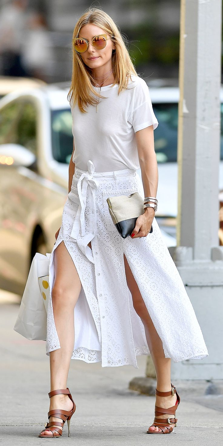 Giving us yet another reason to wear summer whites, Olivia Palermo nails the monochromatic motif with a breezy eyelet skirt and relaxed tee. Subtle hints of warm neutrals—oversized gold shades, cognac sandals, a color-blocked canvas pouch—break up all that solid color in the chicest possible way.