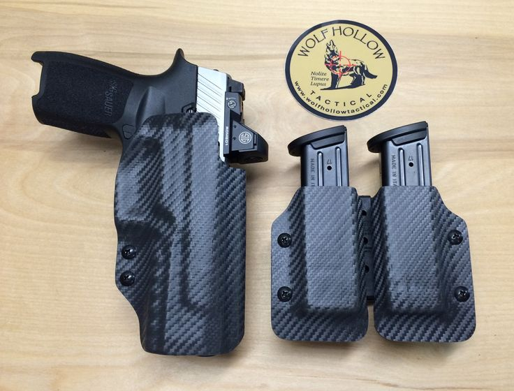 A custom holster for a Sig Sauer P320 with RMR. Dual mag carriers with Tek-Lok in grey carbon fiber. www.wolfhollowtactical.com  #kydex #holster #sig #sigsauer #p320 #everydaycarry