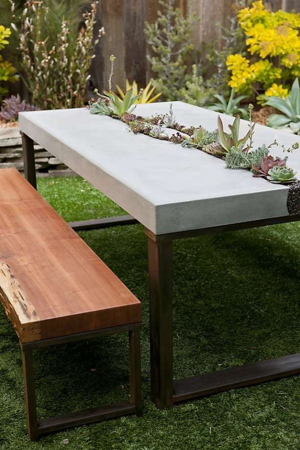 Concrete succulent table. Five Feet from the Moon¡¦s elegant table features a living centerpiece and redwood benches made from a fallen tree. $6,000, including plants, $8,000 with redwood benches. www.fivefeetƒ©fromthemoon.com Photo: ©E.Spencer Toy/Sunset Publi
