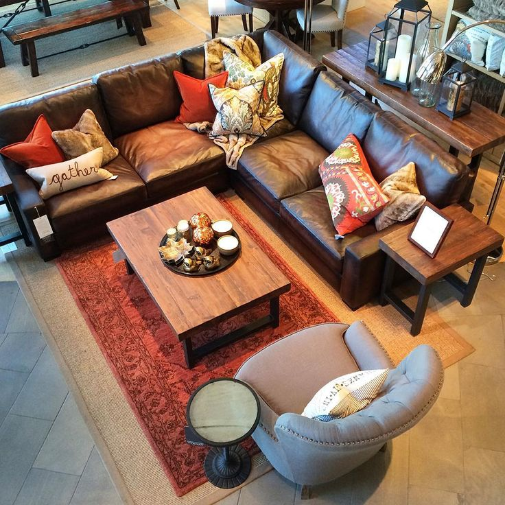 Find an inspiration to create your space. Here we used autumn colors to set the tone. Persian Rug pulls out the orange off the textiles, creating an inviting sitting area on our Leather Sectional. #potterybarn #visualinspiration