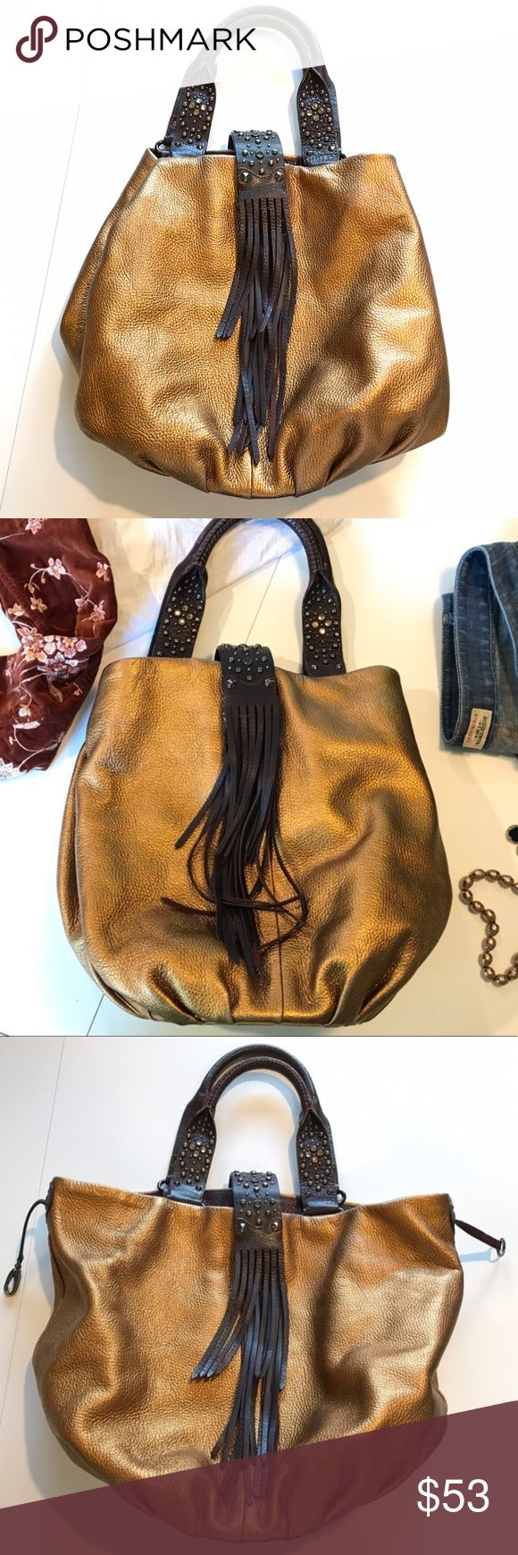SALE ❗️Cole Haan G Series Large hobo Leather bag Limited edition G series Leather bag, metallic bronze color, bohemian chick style with dangling jewels charms. Some of the metallic color is rubbed off, other than that, this purse is in great condition. No stains, no scratches, all zippers work! Join me on @poshmarkapp, follow me @tupirix Sign up with UCDHC to get $5 off your first order. https://bnc.lt/focc/oTzFSGls7D Cole Haan Bags Hobos
