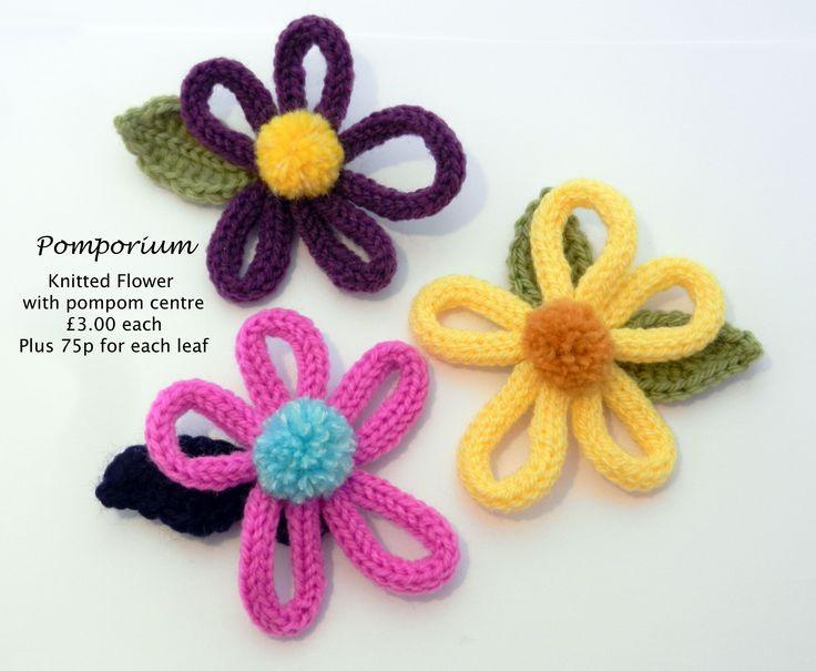 Pompom knitted flowers used for decoration @ www.facebook.com/pomporium/
