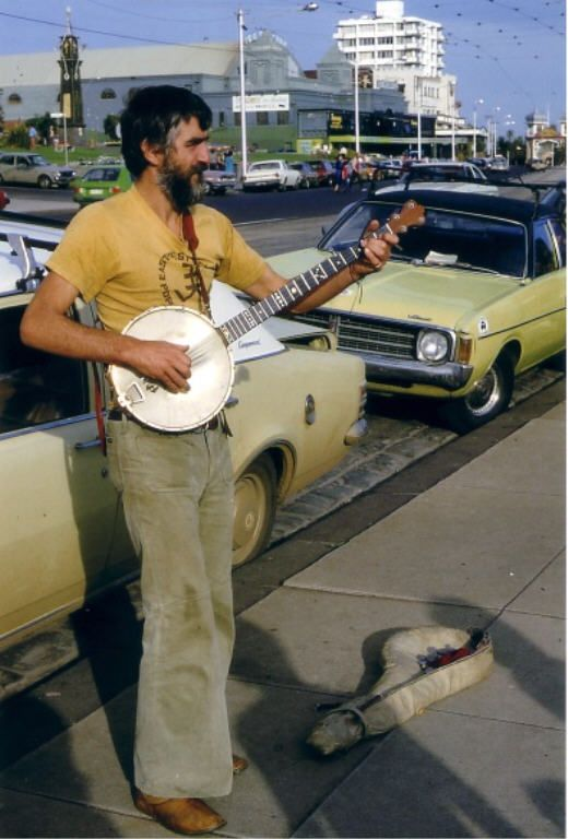 Busker St Kilda 1980 Note: The old ice ring in the background next to the espy, long since gone.