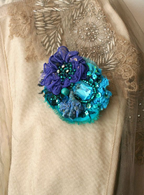 Romantic lightweight brooch, mixed media, with sculpted silk bloom and hand beading. Adorned with seed beaded details, sculpted clay. Brooch is