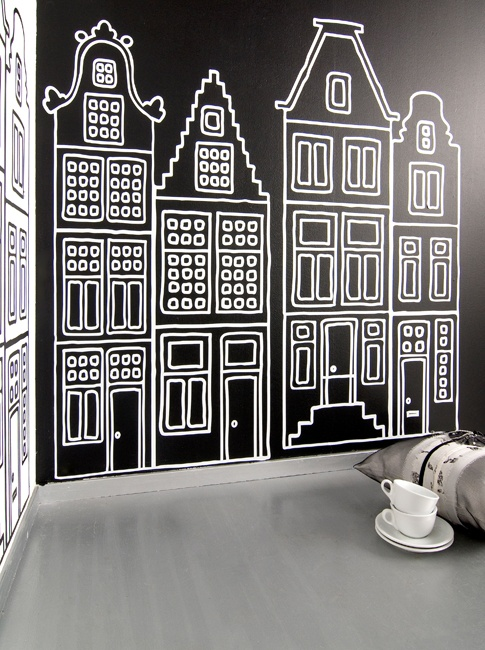 A Dutch cityscape in monochrome and reverse colours on adjoining wall - makes a great backdrop for fun and bedroom can be kept black and white or with added brights for accent and interest.