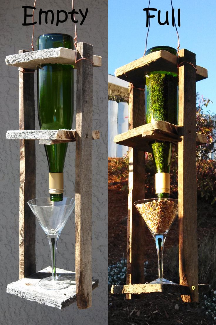 Wine bottle bird feeder! We made this from an old pallet, an empty wine bottle, and thrift store martini glass (plus a little leftover copper wire for hanging). The bottle slides out for easy filling. Reduce, Reuse, and Recycle to make cute, useful projects. :) (Dunway Enterprises) http://dunway.info/pallets/index.html