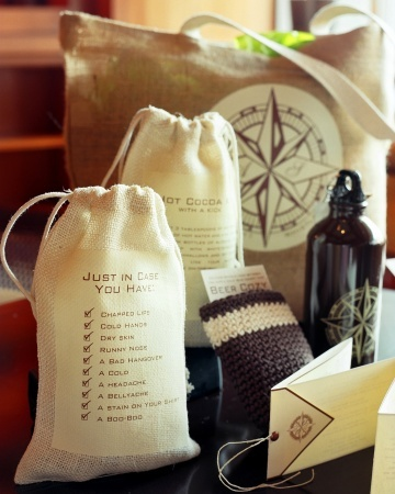 """This natural jute tote contained a spiked hot-cocoa kit and a personalized aluminum water bottle marked with a cheeky tag inviting guests to fill it with """"water or alcohol, whichever you need more."""""""