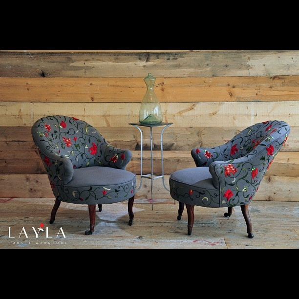 Chairs with hand embroired floral patterns at the gallery..