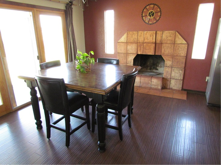 The unique wood burning kitchen sets off this dining area for Unique kitchen dining sets