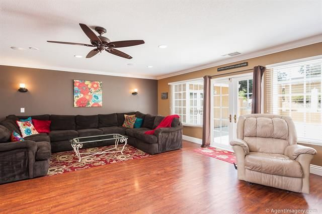 Living / Family room with tons of natural light streaming in from the French doors with dual pane windows. Surround sound speakers, wood laminate flooring and crown molding complete the room luxuriously. 1542 Hidden Mesa Rd, El Cajon, CA 92019