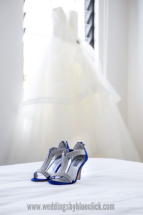 Pretty blue shoes. Photography by Blueclick Photography. Location : Sea Temple Port Douglas.