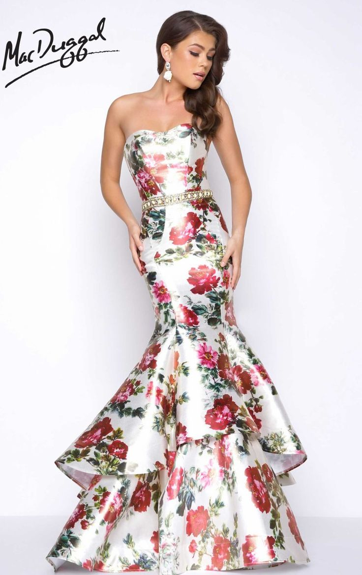 Add a modern vibe to your stylish look in Mac Duggal Prom 66029M. This long gown offers a strapless and sweetheart neckline. High-class beads belted the waist with tiered mermaid skirt finishes the look. Floral prints paint the entire outfit for a daintier look.